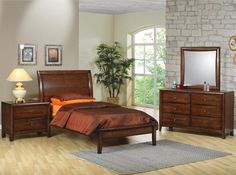 This stunning platform bed will add a sophisticated look to the youth bedroom in your home. A high gently curved headboard features chamfered trim, with sleep s