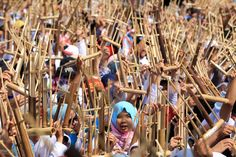 People play the angklung, a traditional Indonesian instrument, during the commemoration of the Asian-African Conference in Bandung, Indonesia, on Thursday. RAMDHANI/XINHUA/ZUMA PRESS