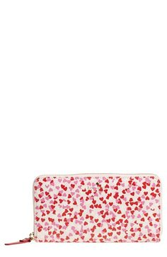A playful, vibrant confetti print dapples a durable zip-around wallet that's also perfect as a chic clutch. Kate Spade.