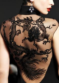 This is not a tatoo; it is velvet burnout!  I love this!  It is way less painful than a real tat!