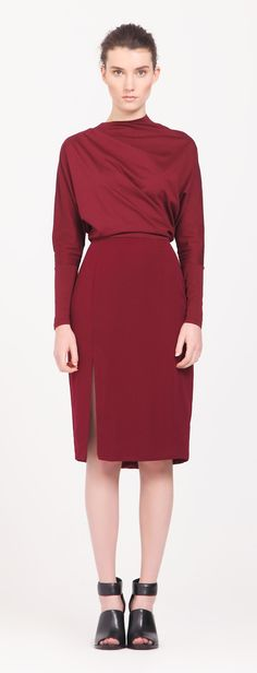 High Neck Draped Dress with V Back Neckline in Burgundy Update your office wardrobe with this beautifully-tailored high neck dress, featuring a draped jersey batwing top and V back neckline, with a fitted skirt with side split. Pair with high-heeled pumps for a smart finish. https://www.paisie.com/collections/dresses/products/high-neck-draped-dress-with-v-back-neckline