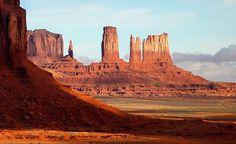 MonumentValley In #USA  The valley is not a valley in the conventional sense, but rather a wide flat, sometimes desolate landscape, interrupted by the crumbling formations rising hundreds of feet into the air, the last remnants of the sandstone layers that once covered the entire region.