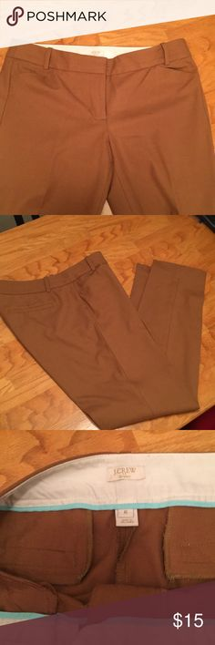 Ankle stretch size 8 JCREW These pants are tampered and hit at ankle. Material has some stretch. Pants are worn but in good condition some polling that can be removed with lint shaver. Dry cleaning only. Color is dark tan like a peanut color J. Crew Pants Ankle & Cropped