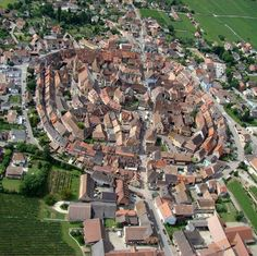 When looking at a photo of Eguisheim taken from above, it is easy to be amazed by the shape of this small medieval city, which was built in three concentric circles around his castle. The Medieval well-preserved Eguisheim Village, Alsace, France