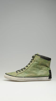Cotton vintage sneakers featuring zip fastening and waxed lace closure, rubber sole, metallic eyelets.
