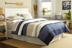 Give your bedroom a fresh update with the Grand Bank comforter set. This sharp and sophisticated comforter features a series of soothing earth-tone colorblocks that reverses to a solid navy. Included plaid sheet set finishes everything off in style.