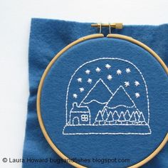 Embroider a festive snow globe with this free Christmas embroidery pattern!