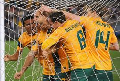 MELBOURNE, AUSTRALIA - JUNE 11: Mark Bresciano of Australia is congratulated by team mates after scoring a goal during the FIFA World Cup Qualifier match between the Australian Socceroos and Jordan at Etihad Stadium on June 11, 2013 in Melbourne, Australia. (Photo by Vince Caligiuri/Getty Images)