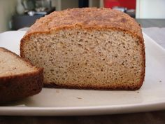 Healthy Gluten Free and Low Carb Bread Recipe Breads with almond flour, coconut flour, flax seed meal, salt, baking soda, eggs, coconut oil, honey, apple cider vinegar