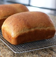 This oatmeal bread recipe makes two loaves. It's a great tasting oatmeal bread flavored with molasses, great for breakfast toast, or serve with baked beans or as a sandwich bread.