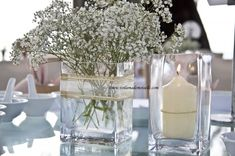 with a turqouise bow. if doing your wedding outdoors, you want to have low heavy centerpieces because its super windy in hawaii.  you can use sand from the beach to weigh them down, and still manage to put your water and flowers inside too!  the sand will also help hold the flowers inside their vase