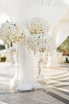 Glamorous white rose centerpieces: http://www.stylemepretty.com/california-weddings/dana-point/2016/04/25/glamorous-ballroom-wedding-thats-got-florals-for-days/ | Photography: Jana Williams - http://jana-williams.com/