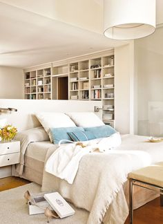 pendant + built-ins + half-wall in neutral bedroom via  El Mueble