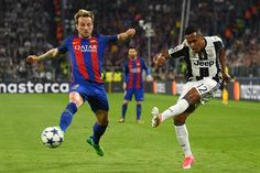 Alex Sandro of Juventus gets in a cross despite the efforts of Ivan Rakitic of Barcelona during the UEFA Champions League Quarter Final first leg match between Juventus and FC Barcelona at Juventus Stadium on April 11, 2017 in Turin, Italy.