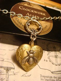 Tiny  Bumble Bee Heart Locket Necklace 1759 by ClockworkAlley, $24.00 #bee #beelocket #beenecklace #beejewelry #heartlocket #locket