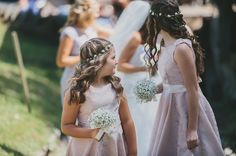 young bridesmaids in pink with petite baby's breath bouquets & floral crowns / Mckinley-Rodgers Photography