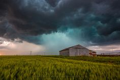 Title:  Rainy Day.  A beautiful scene of an old barn in southwest Oklahoma and a spring thunderstorm.
