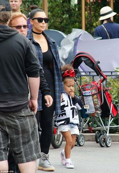 Festive: North was dressed for the occasion in black and red sequined Minnie Mouse ears