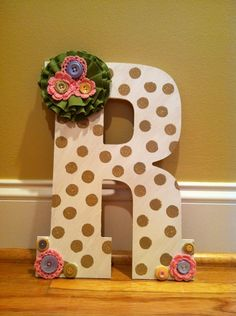 Wooden letter I painted and decorated with crochet rosettes and pastel buttons. All found in craft section at Hobby Lobby. Birthday gift for a friends front door.