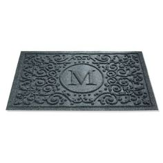 The Water & Dirt Shield Mandalay Door Mat holds dirt and a gallon of liquid, even when it's picked up. Thick polypropylene fibers whisk mud from your shoes and pet's feet to keep your entryway clean.Monogram door mat only allows letters, no numbersDoor mat will not fade, deteriorate, mildew, or succumb to heavy foot trafficSlip-resistant recycled tire backingSuitable for all floor typesRinses clean with a hoseNote: Do not place on wet floors Made in USA.