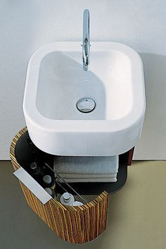 Happy D Cantilevered Sink - Wall-mount lavs make small baths look big by opening up floor space. Problem is, they lack the storage capacity of freestanding vanities. Not the Happy D sink, which has an attached cabinet that hovers above the tile, rather than resting on it. From Duravit.com
