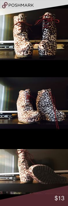 Blk and White Cow Print/Red Laced Up Wedge Booties Hot/Sexy Black and White Cheetah Print, Red/Black laced up Wedge Booties!!! Size 6, 4 1/2in wedge. 1in platform. Bought from a posh seller. A little to steep for my ankle support so I can't wear them, but they are very stylish and unique. Xhilaration Shoes Ankle Boots & Booties