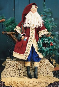 24 Tall Folk Art Old World style Santa Body is muslin that was painted and stained. Face is needle sculpted. Beard is wool. Coat and hat is trimmed with monks cloth and adorned with red beads and tiny felt leaves. Instructions for wreath and small doll in pocket included. PDF download comes comple