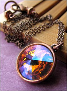 Captivating Swarovski crystal pendant in a color that is like iced fire--brilliant orange is set off by a special coating with flashes of hot pink, magenta and cool cyan.