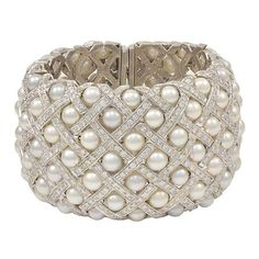 "Magnificent and majestic extra wide 18K white gold, pearl and approximately 5 cts of diamond cuff bracelet. 1.5"" wide and fits 6.5""-7.5"" wrist. Heavy, solid and fabulous!"
