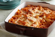 Creamy Baked Ziti--ziti, marinara sauce, diced tomatoes, cream cheese, sour cream, mozzarella cheese & parmesan cheese