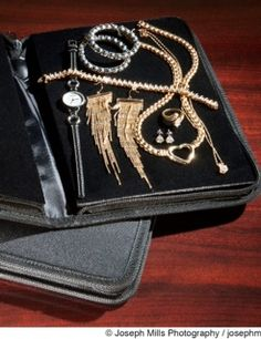 Travel Jewelry Case, nothing moves when zipped inside.  Padded velvet gently squeezes whatever you want in place.