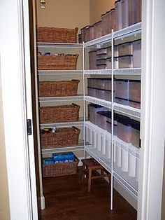 An organized pantry. all canned goods and sauces are in the baskets. everything else in Tupperware.