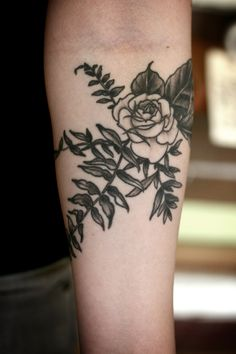 black and grey rose and fern, all healed up! on a nice young lady to came in to get tattooed by stephanie brown today!