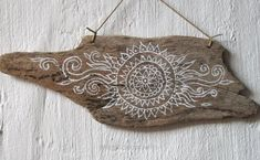 Unbelievable This is a freehand painting of my own ethnic inspired sun design on a particularly lovely piece of driftwood I found. I was waiting to think of a The post This is ..
