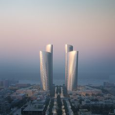 Foster + Partners Unveils Lusail Towers in Qatar, a Landmark Project for a New Central Business District in the City | ArchDaily New Football Stadiums, Concrete Facade, Foster Partners, Architecture Images, Amazing Architecture, Solar Shades, Thing 1, Central Business District, Zaha Hadid Architects