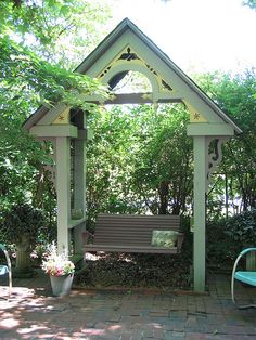 This architectural focal point makes a comfortable place to visit with backyard guests.