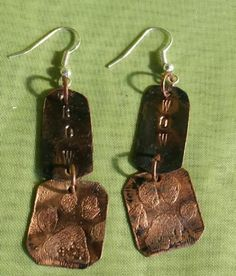 Lightweight, metalworked  and antiqued copper earrings.  Hours of labor and time are involved in making jewelry by a metal-smith using forging and coloring techniques. Each piece of my handmade jewelr