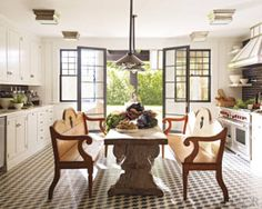 PATTERNS UNDER FOOT    Designer Steven Gambrel used black, white, and gray French tiles to accentuate the European flavor of this bright kitchen in Southampton, New York.