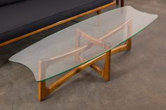 """This is a Mid-Century Modern coffee table by Adrian Pearsall. It has a  sculptural walnut base and the original glass top. Matching side tables  also available.  Great condition on the base. The original glass top has scratches.  Measurements:  59""""L x 20.13""""W x 19.5""""H  REQUEST A SHIPPING QUOTE  MAKE AN APPOINTMENT TO VIEW THIS ITEM"""