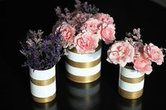 Use old cans to make these gold and white striped vases.
