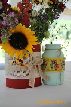 Recycle cans and jars for wedding centerpieces.Paint with chalky paint for a rustic, yet elegant look. So pretty!