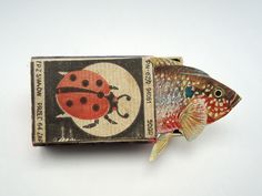 "mano k., art box nr 161, 09.june 2012, ""metamorphose""  A true paper artist.  Retro inspired vintage matchbook with fish.  The graphics and details superb"