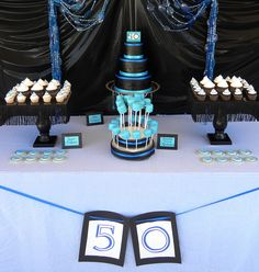 Dessert buffet for a 50th birthday! The buffet included: 3-tier cake, cupcakes, sugar cookies, and chocolate covered marshmallows!