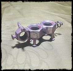 Pig made from recycled metal hardware that was re-purposed to save lives, 100% of proceeds go directly to Flip Side Sanctuary, a nonprofit farmed animal sanctuary. Created by co-founder, Gregg Holm. Approximately 4 inches long.