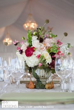 Low centerpieces in a moss painted vase with hydrangea, scabies pods, roses, belles of Ireland and sweet peas. Gorgeous! #rustic #glam @bacioccophoto Location Viansa Winery