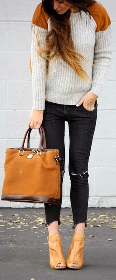 color blocked sweater + ripped black jeans.