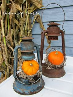 Vintage Rustic Fall Lanterns - red and blue lanterns with moss and white pumpkins