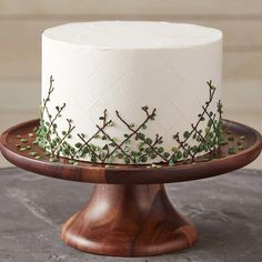 Sometimes the simple designs are the most striking, and that's certainly true with this Leafy Lattice Cake.  A lovely cake for Mother's Day, birthday celebrations or even for a garden party or spring brunch, this garden-inspired cake features leaves made a day in advance, so decorating is easy breezy the day of the party.  Personalize your lattice cake with a message or leave it as is for a visually appealing centerpiece that's sure to be the talk of the town!