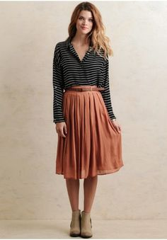 Rustic and charming, this orange-hued midi-skirt features a semi-pleated design perfect for pairing with all your favorite fall pieces. Finished with a brown belt closure and  hidden side zi...