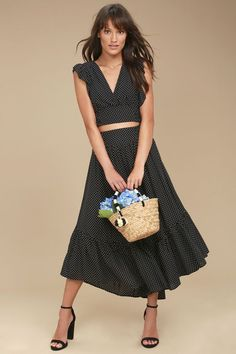 Let the romance begin with the Free People Pretty Daze Black Polka Dot Two-Piece Dress! This woven, polka dot two-piece dress features a surplice crop top with ruffled short sleeves, tying sides, and a smocked back. Matching midi skirt has a smocked, high-waist and ruffled, high-low hem.